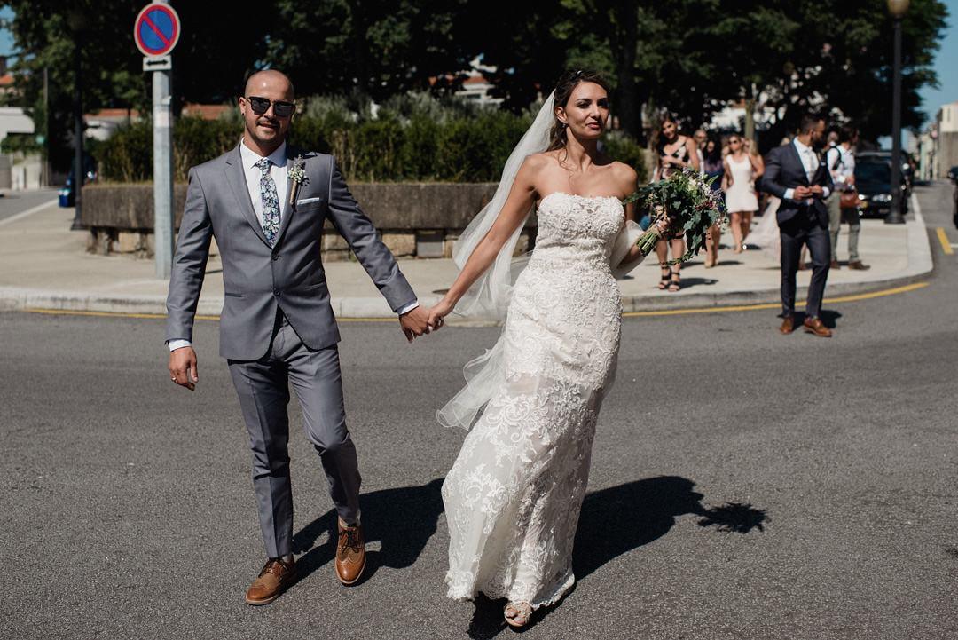 bride and groom walking on porto streets