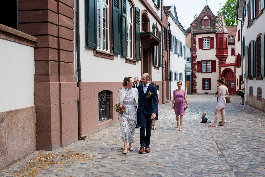 bride and groom walking in basel